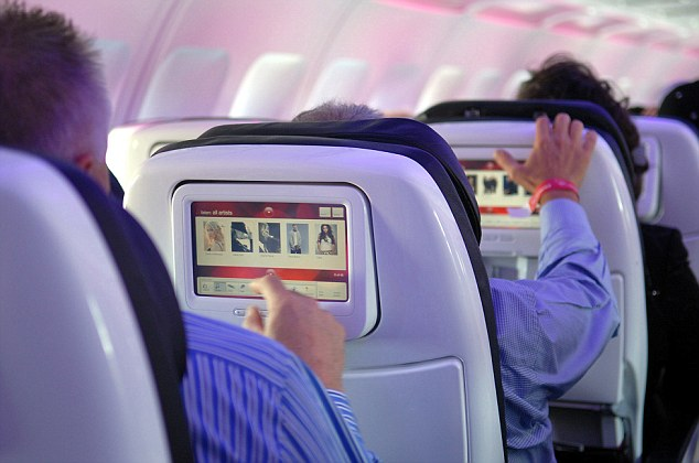LOS ANGELES, CA - AUGUST 08: Passengers seated in custom-designed leather chairs try out Virgin America airlines in-flight entertainment system which includes on-demand movies, television, video games,music and onboard chat rooms during the first flights of Virgin America from Los Angeles and New York to its base of operations in San Francisco, California, Wednesday, August 8, 2007. (Photo by Bob Riha/WireImage)