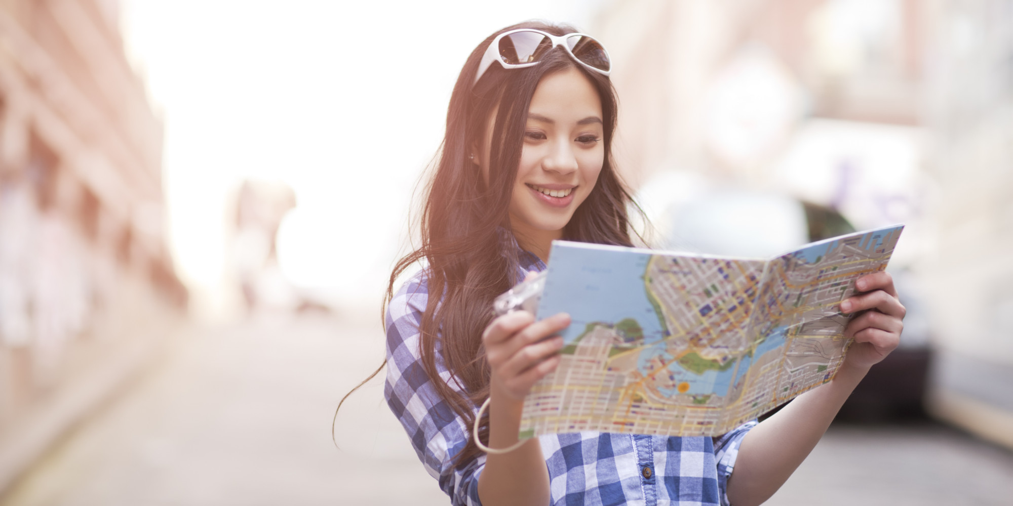 Chinese woman looking at map